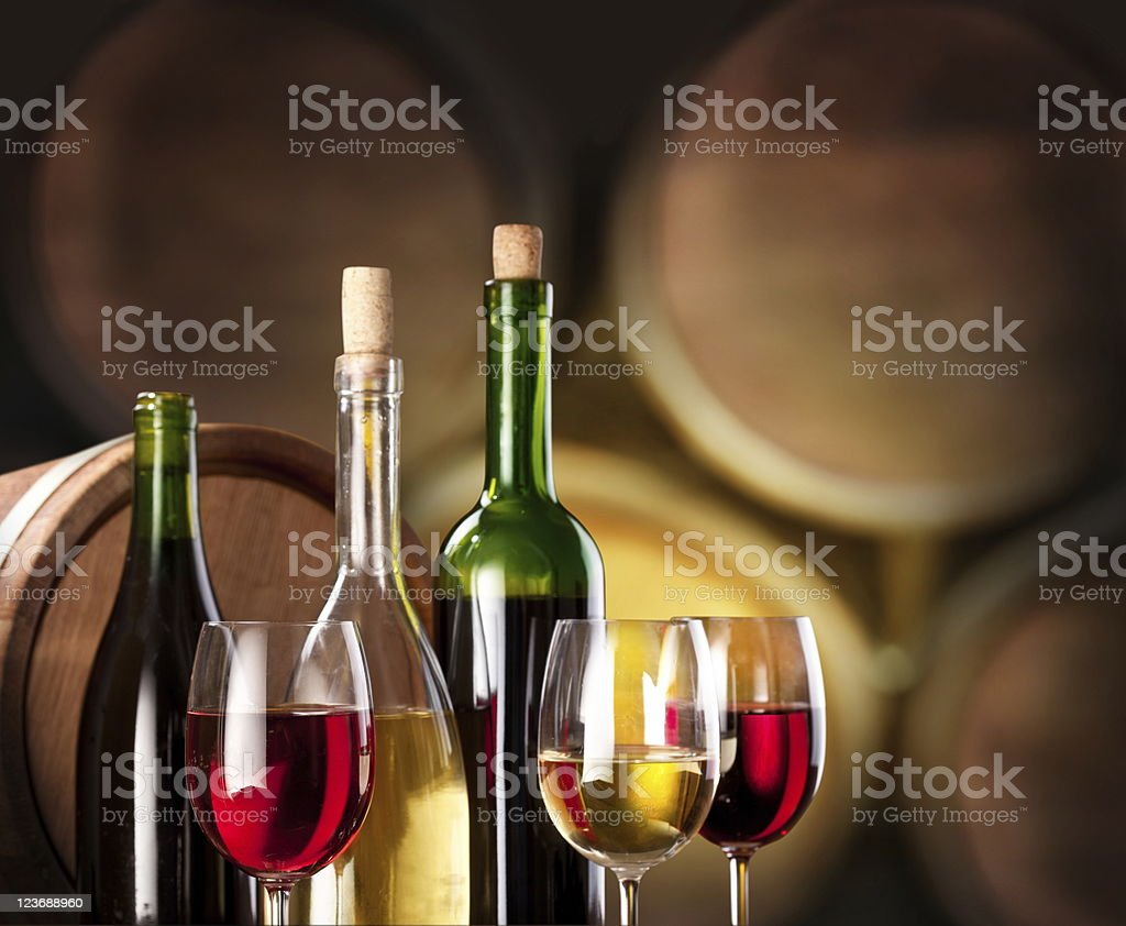 Glasses and bottles of wine in the cellar royalty-free stock photo