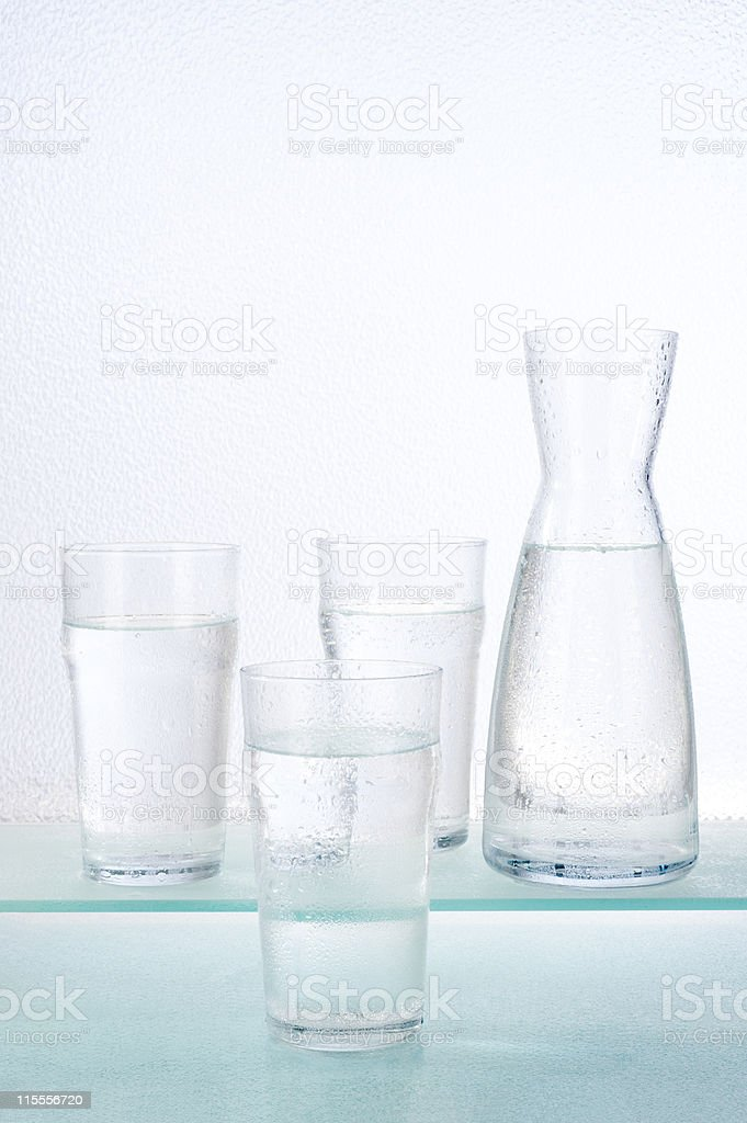 glasses and carafe with water stock photo