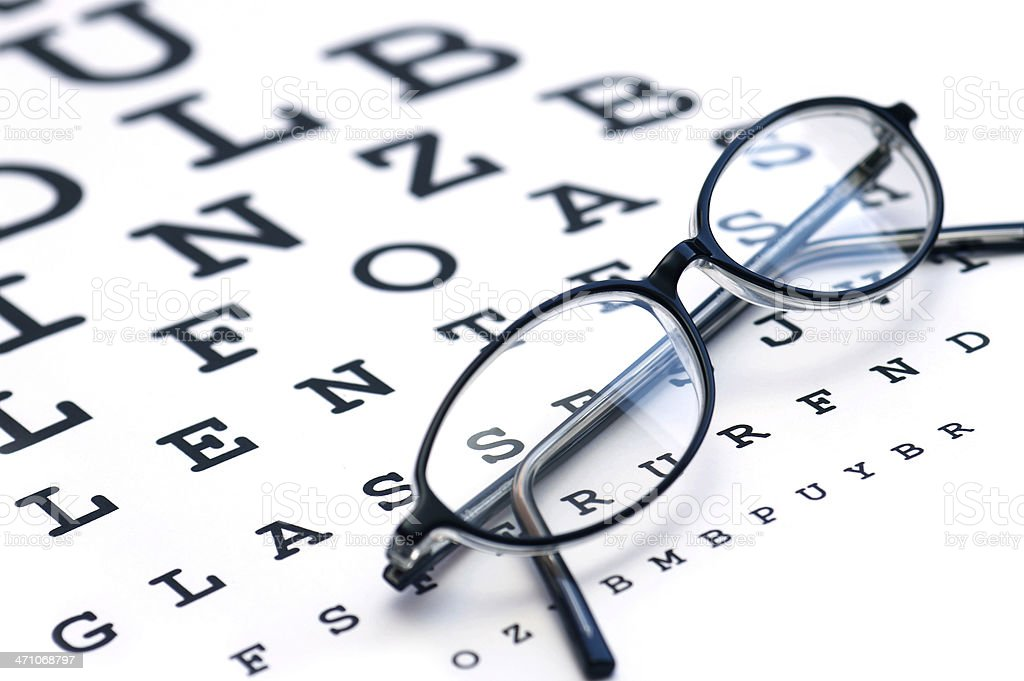 Glasses and eyechart stock photo