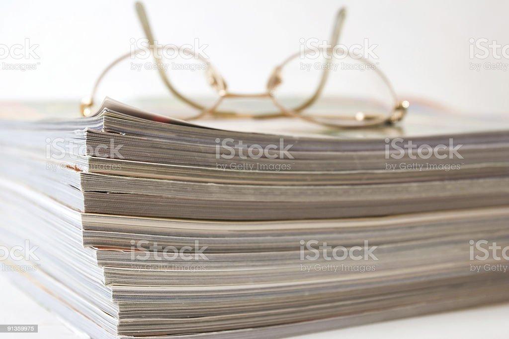 Glasses and Magazines stock photo