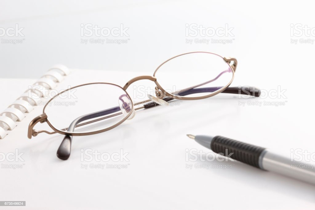 Glasses and pens royalty-free stock photo