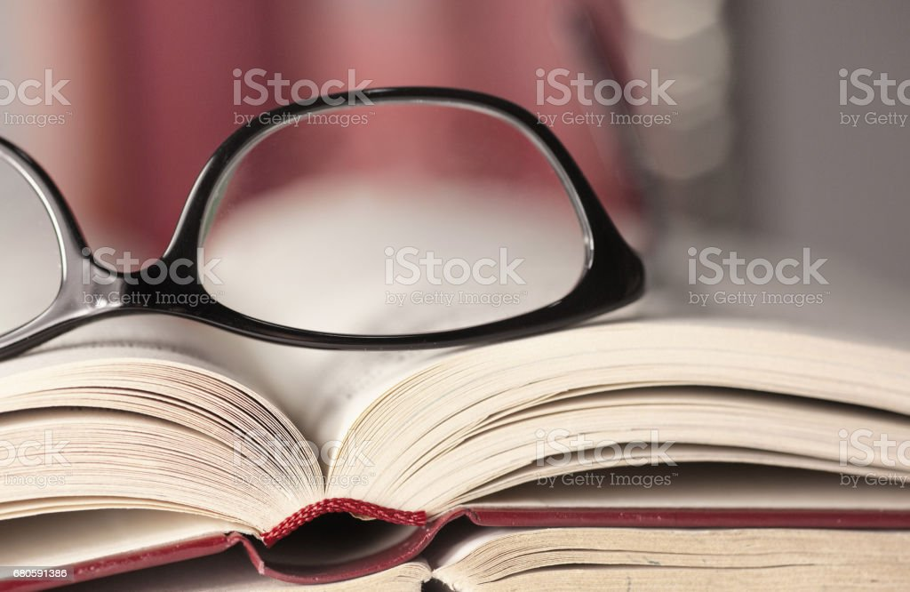 Glasses are laying on a book stock photo