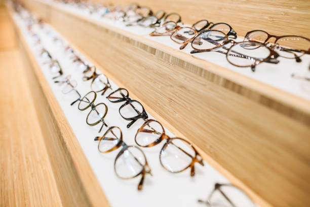glasses at prescription eyeglass shop - eyewear stock pictures, royalty-free photos & images