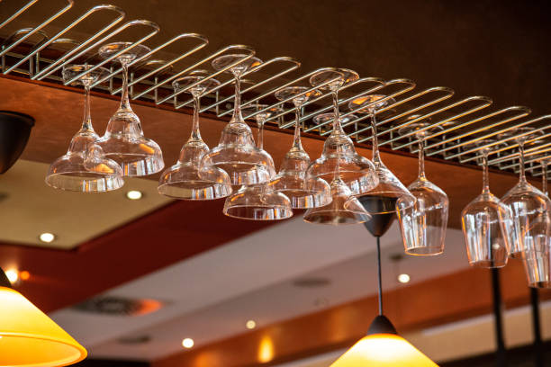 Glasses at the bar on the ceiling stock photo