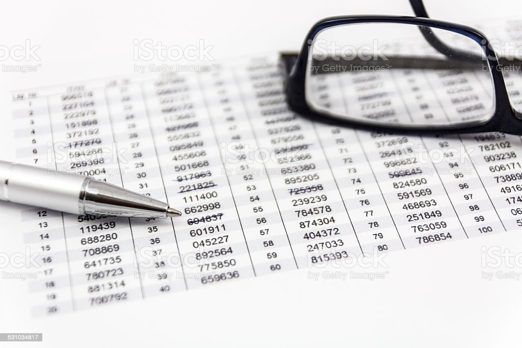 Glasses, ballpoint pen and TAN list for online banking