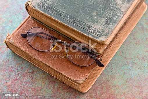 1034955096 istock photo Glasses, books and study material 913876834