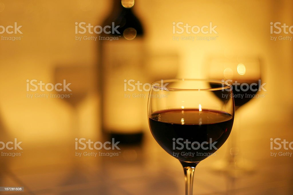 Glasses & Bottle of Red Wine with Light and Shadows royalty-free stock photo