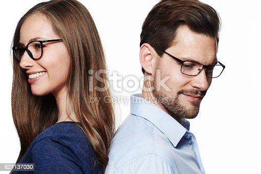 istock Glasses couple looking away 621137030