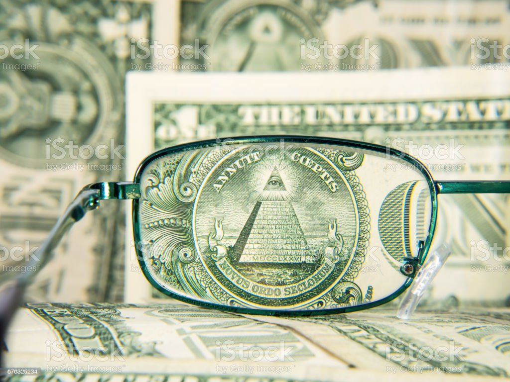 Glasses focused on dollar banknote with pyramid, detail stock photo