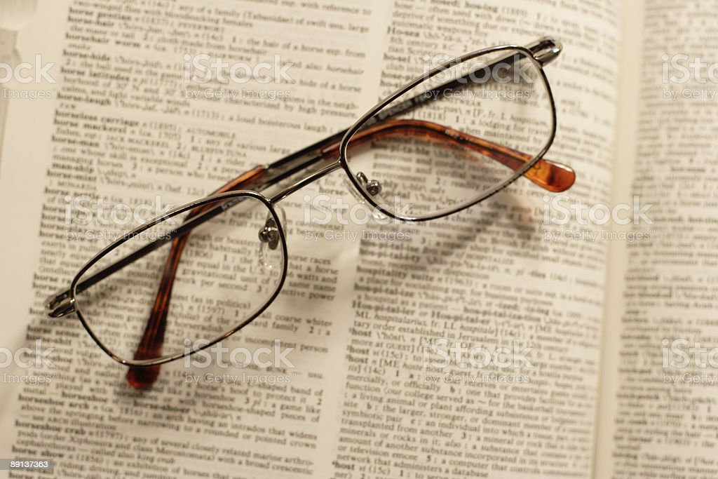 Glasses Folded on a Book stock photo