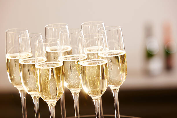 Glasses full of champagne on a tray Champagne drinks being served on a tray epernay stock pictures, royalty-free photos & images