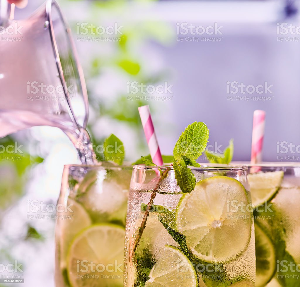 Glasses group with alcohol drink and striped cocktail straws. stock photo