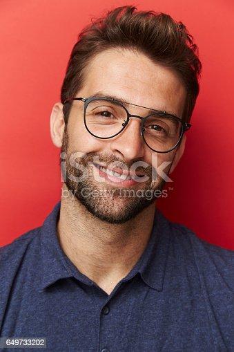 649754038 istock photo Glasses guy in blue 649733202
