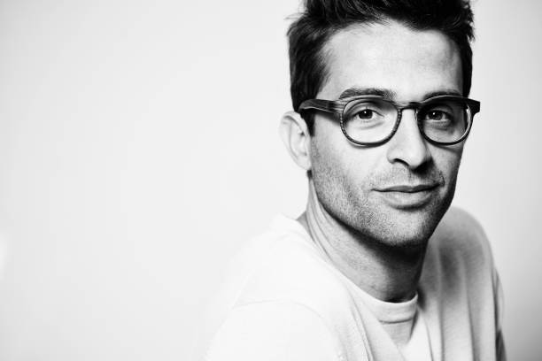 Glasses guy Good looking glasses guy in studio monochrome stock pictures, royalty-free photos & images