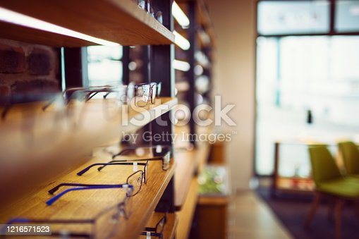 Glasses in an optician's shop sorted in a row on the shelf