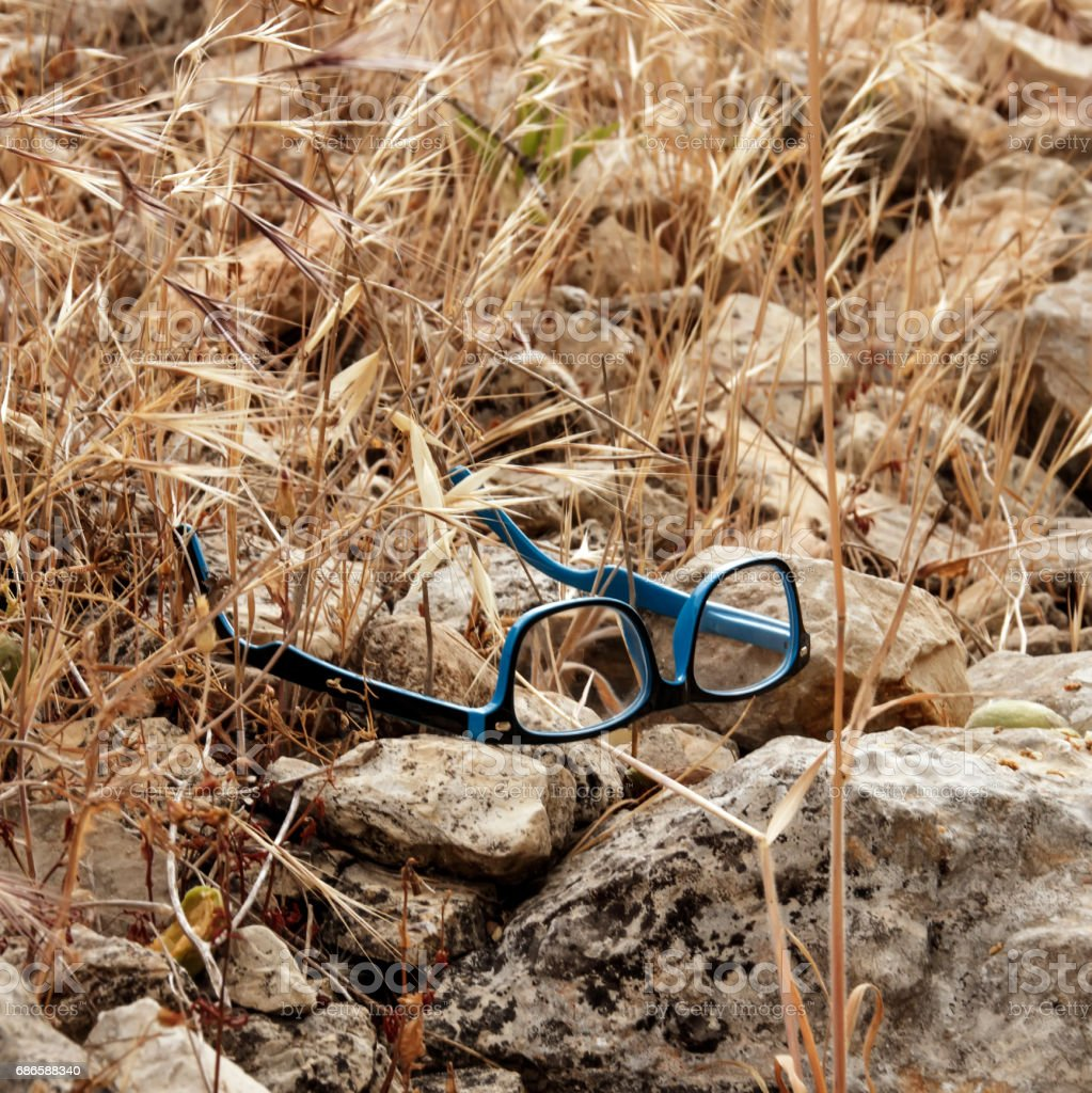 Glasses lie on stones royalty-free stock photo