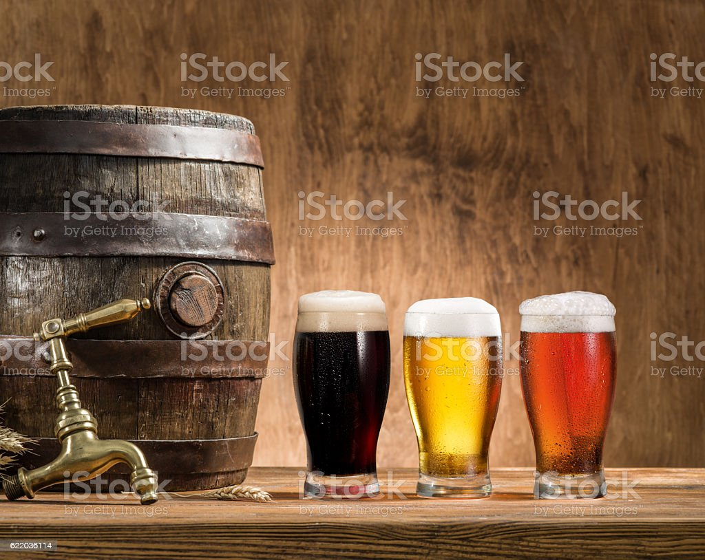 Glasses of  beer and ale barrel. stock photo