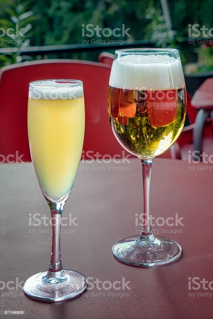 Glasses of beer and lemon beer on outdoors bar table. stock photo