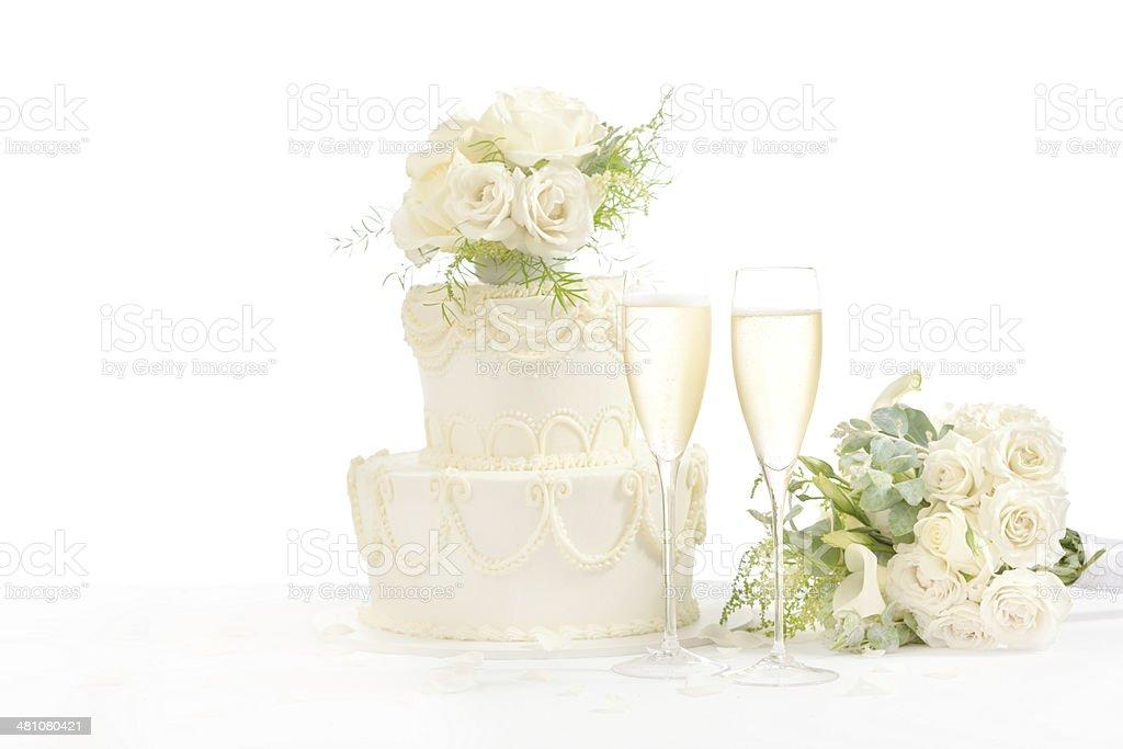 Glasses of Champagne and Wedding Cake on White Background Horizontal stock photo