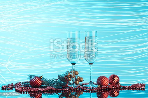 1144550840 istock photo Glasses of champagne on neon background. 869758364