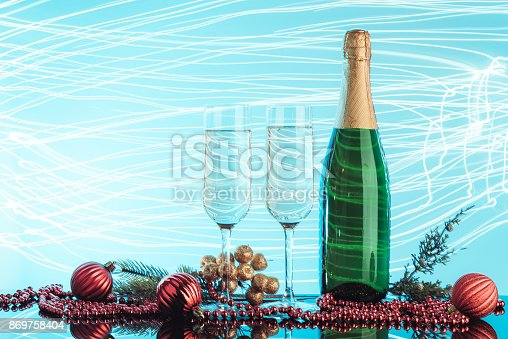 1144550840 istock photo Glasses of champagne on neon background. 869758404