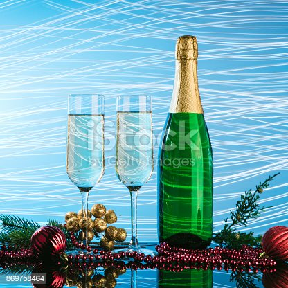 1144550840 istock photo Glasses of champagne on neon background. 869758464