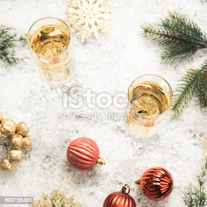 1144550840 istock photo Glasses of champagne on snow. 869758480