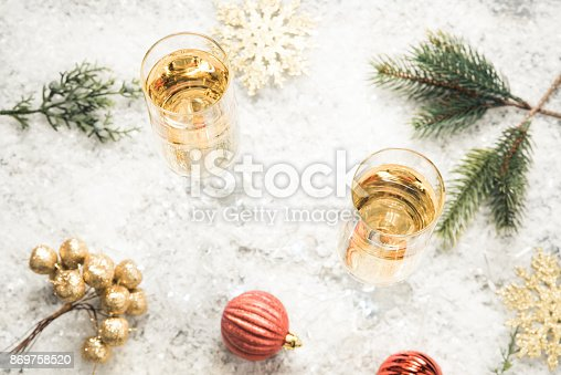 1144550840 istock photo Glasses of champagne on snow. 869758520
