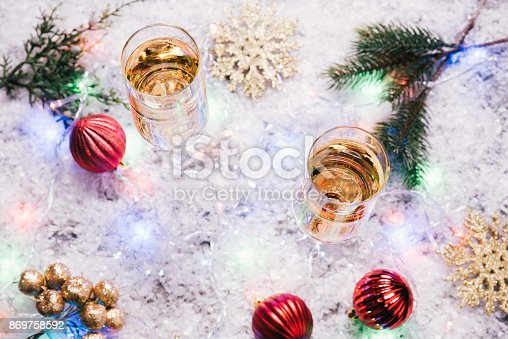 1144550840 istock photo Glasses of champagne on snow. 869758592