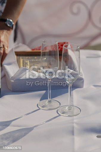 istock Glasses of champagne on the table on a sunny day 1206602675