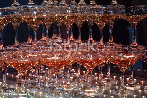 istock Glasses of champagne. Pyramid of wineglasses. 865339466