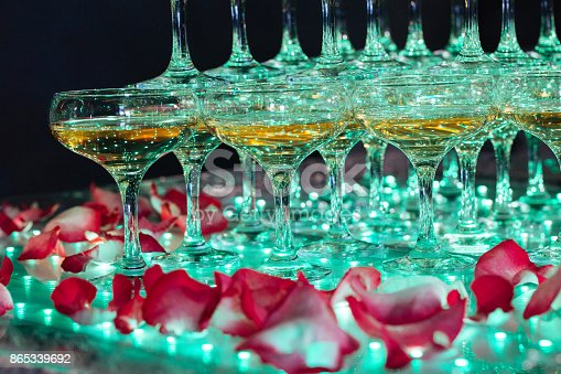 istock Glasses of champagne. Pyramid of wineglasses. 865339692