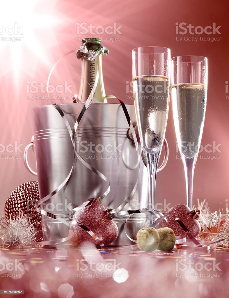 glasses of champagne with a cooler on a red background stock photo