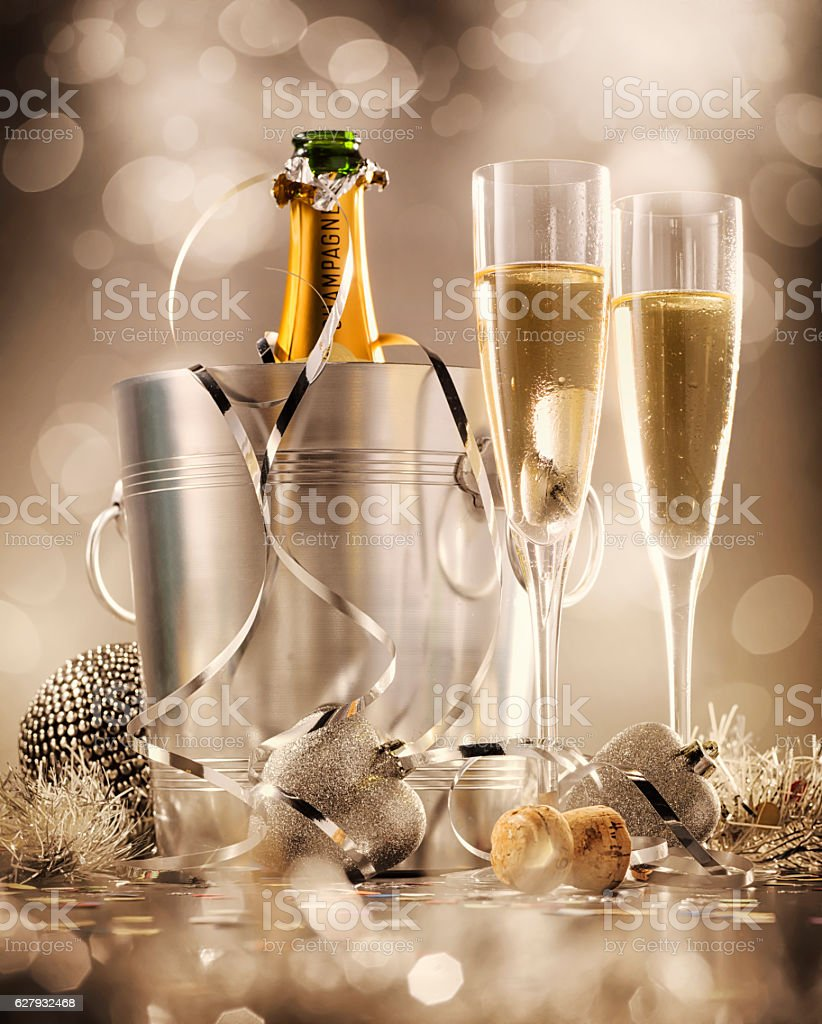 Glasses of champagne with bottle in cooler in the background stock photo