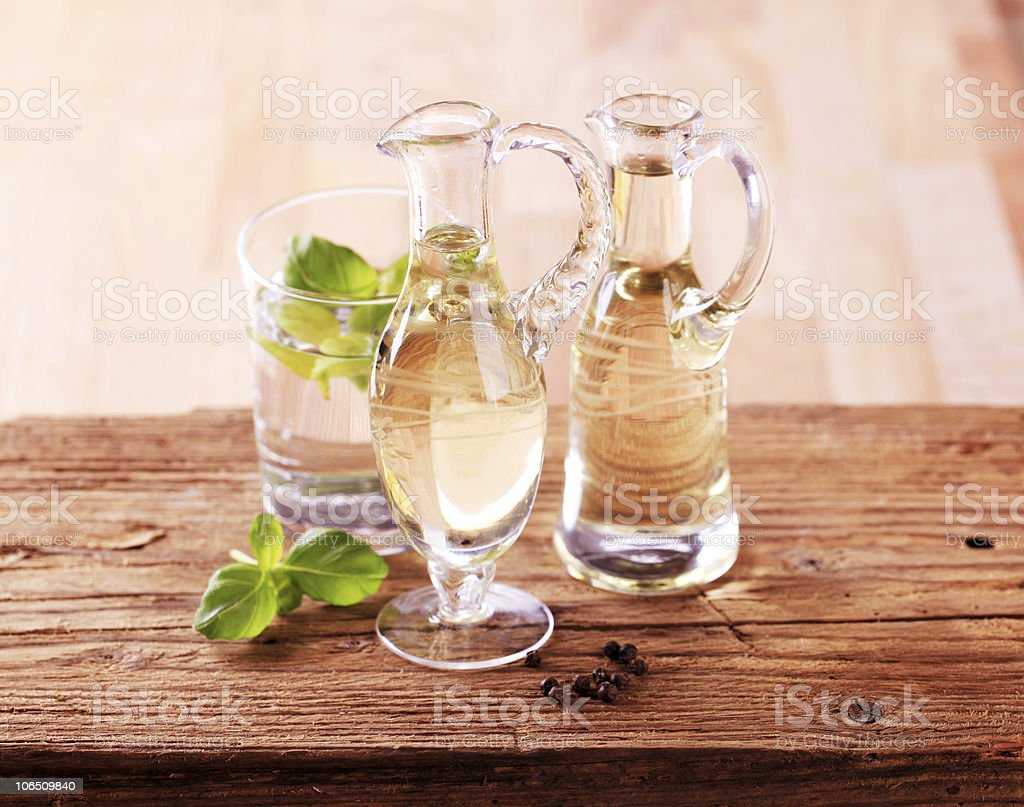 Glasses of condiments next to drink stock photo