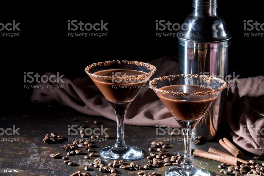 glasses of cream coffee cocktail or chocolate martini on black...