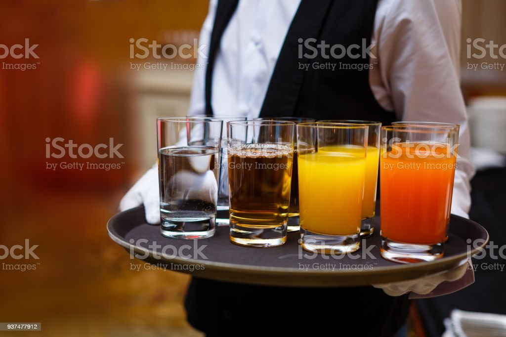 Christmas Drinks Alcohol.Glasses Of Drinks On A Waiters Tray New Year Or Christmas
