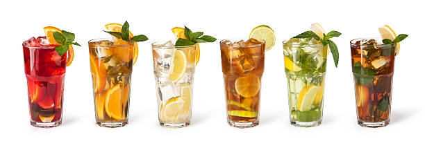Glasses of fruit drinks with ice cubes set with different cocktails on white background mojito stock pictures, royalty-free photos & images