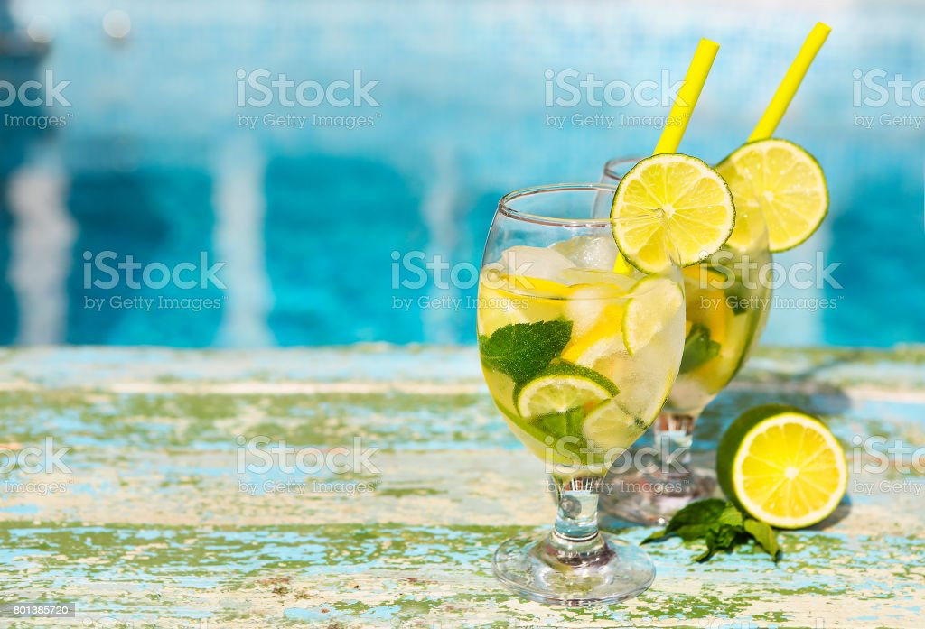 Glasses of homemade lemonade on a rustic wooden background stock photo