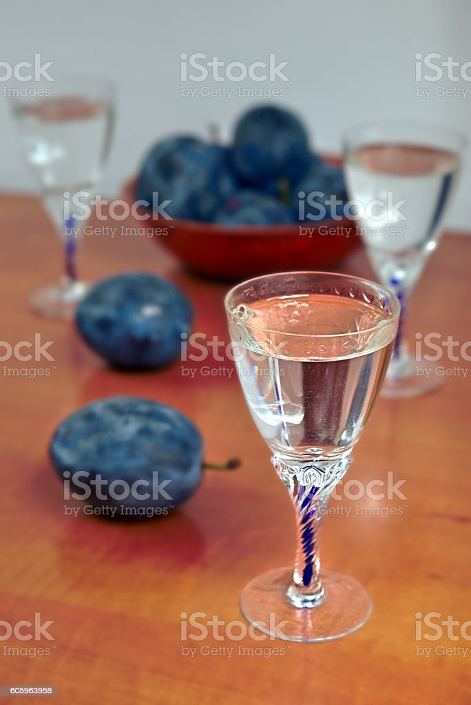 Glasses of homemade plum brandy with plums stock photo