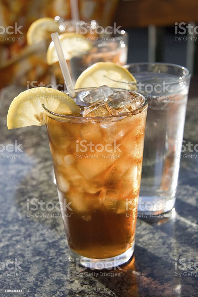 Glasses of Iced Tea and Ice Water with Lemon Wedges royalty-free stock photo