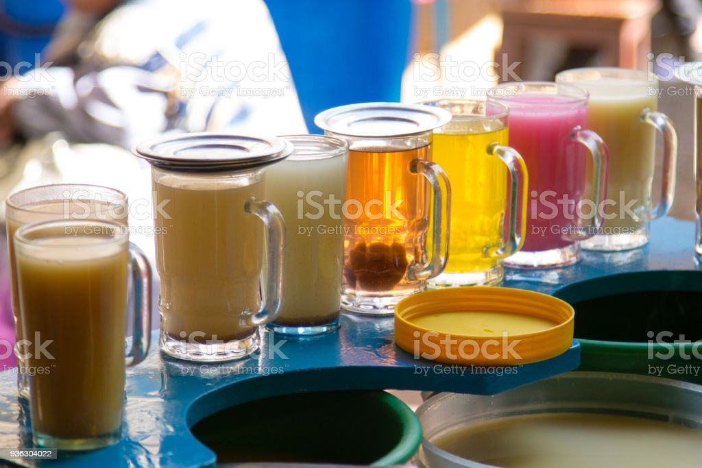 Glasses of juice in a row stock photo