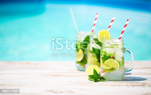 istock Glasses of lime lemonade near pool 665212606