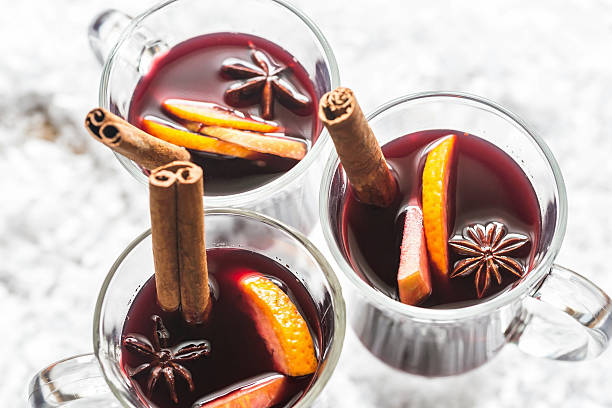 glasses of mulled wine in snow - mulled wine stock photos and pictures