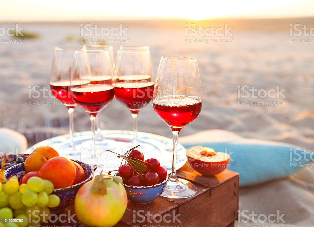Glasses of red wine on the sunset stock photo
