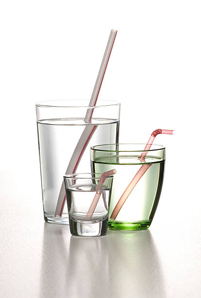 glasses of water with pipette stock photo