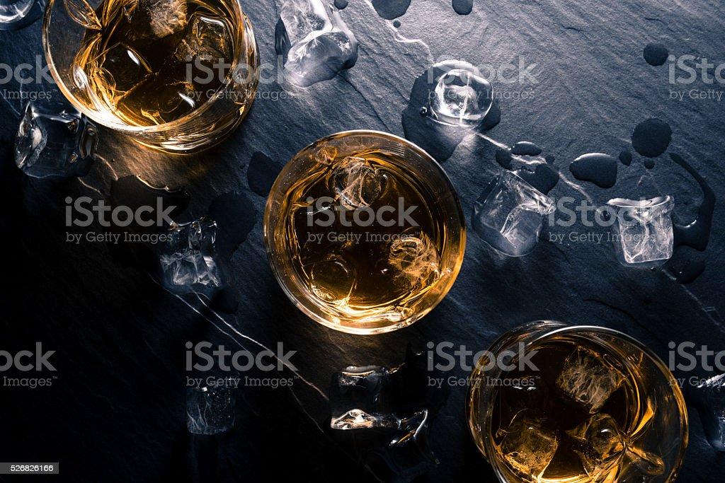 Glasses of whiskey on dark table stock photo