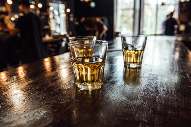 glasses of whiskey on the table stock photo