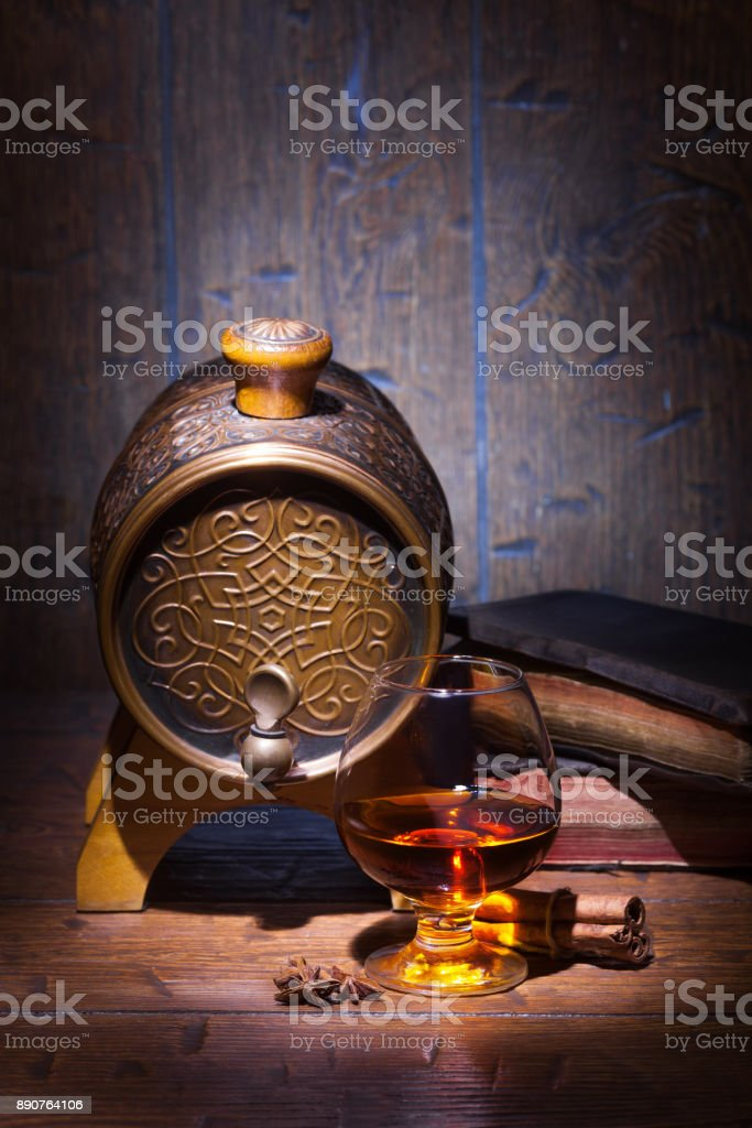 Glasses of whiskey, spicery, books and small barrel stock photo