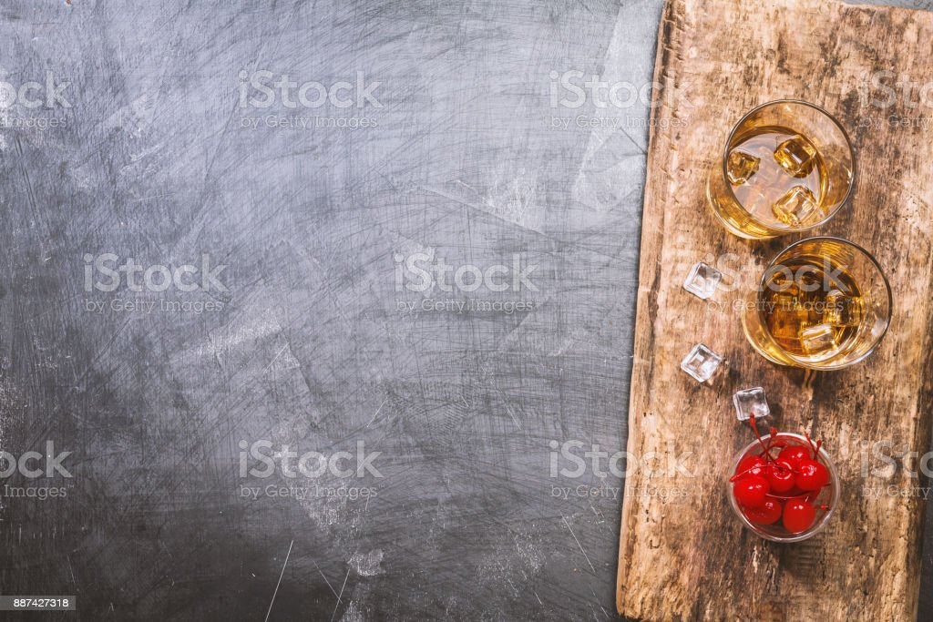 Glasses of whiskey with ice stock photo